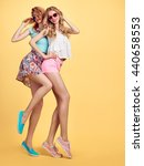 Small photo of Fashion Hipster woman Having Fun Crazy Cheeky Dance. Hipster Sisters in Stylish Summer Outfit. Funny Model Girl in Sunglasses. Glamour Trendy fashionable Hairstyle