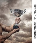 silver cup in dirty hands on... | Shutterstock . vector #440787838