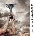 silver cup in dirty hands on... | Shutterstock . vector #440787850