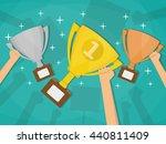 hands holding trophies winner... | Shutterstock .eps vector #440811409