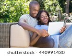 young couple relaxing on the... | Shutterstock . vector #440991430