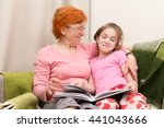 grandmother and granddaughter... | Shutterstock . vector #441043666
