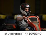 young man is driving go kart... | Shutterstock . vector #441090340
