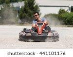 young man is driving go kart... | Shutterstock . vector #441101176