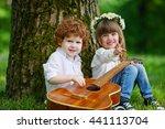 cute children playing guitar   Shutterstock . vector #441113704