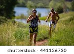 Small photo of Lory State Park, CO, USA - June 18, 2016: Jordan Cooper of Gunnison runs the trails at XTERRA Lory en route to winning the female 25-29 age group.