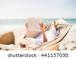 woman reading book in hammock... | Shutterstock . vector #441157030