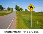 Horse Crossing Sign On Rural...