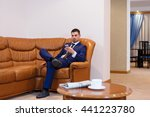 young businessman reading... | Shutterstock . vector #441223780