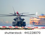 Small photo of NEW YORK, USA - MAY 25, 2016: Navy MH-53 Blackhawks helicopter with the Staten Island Ferry in the background. One of the air crew is seen near the rear door prior to take-off during fleet week.