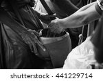 Small photo of two hand of thai people Buddhism give alms to monk in alms bowl, black and white high contrast picture style,selective focus