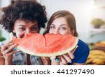 two young women holding slice... | Shutterstock . vector #441297490