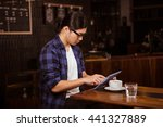 hipster man using tablet in a... | Shutterstock . vector #441327889