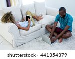 couple using digital tablet and ... | Shutterstock . vector #441354379
