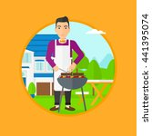 man cooking meat on the... | Shutterstock .eps vector #441395074