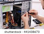 young repairer working with... | Shutterstock . vector #441438673