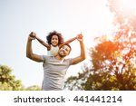 father carrying daughter... | Shutterstock . vector #441441214