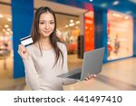 woman shopping on computer with ... | Shutterstock . vector #441497410