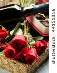 Roses, Wine and Chocolates in a large wicker tray - stock photo