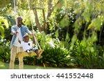 happy family doing swing at park   Shutterstock . vector #441552448