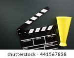 clapper board and megaphone on... | Shutterstock . vector #441567838