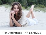 happy woman on the beach.... | Shutterstock . vector #441578278