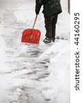 Small photo of Man shoveling snow from the sidewalk in front of his house after a calamitous snowfall in a city