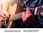 Woman\'s Hands Playing Acoustic...
