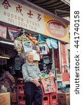 Small photo of HONG KONG - MAR 21: Unidentified hawker (Hudson Store) selling goods in Kowloon Tong district, Hong Kong on March 21, 2015. It is the last day of this old style stall.