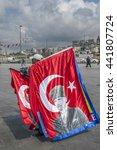 Small photo of ISTANBUL, TURKEY, 2012-09-17: ambulant vendor of Turkish flags with portrait of Ataturk, founder of the modern Turkey near Galata bridge