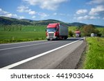 three trucks driving on asphalt ... | Shutterstock . vector #441903046
