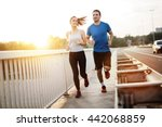 Active Couple Jogging Outdoors...