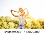 father carrying daughter... | Shutterstock . vector #442070380