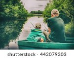 Grandfather And Boy Fishing...