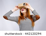 surprised girl looking at... | Shutterstock . vector #442120294