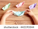 child holds the origami ship in ... | Shutterstock . vector #442193344