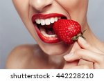 sexy woman eating strawberry.... | Shutterstock . vector #442228210