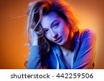 beautiful girl in colored light | Shutterstock . vector #442259506