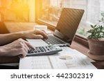 business man using a calculator | Shutterstock . vector #442302319