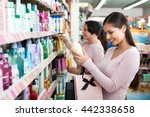 two female customers selecting... | Shutterstock . vector #442338658