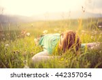 carefree happy man lying on... | Shutterstock . vector #442357054