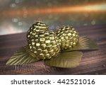 Golden Raspberry On Wooden Desk....