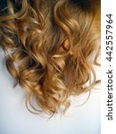 "Small photo of Women's ringlets of color ""amaretto gold"" close-up."