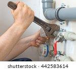 male plumber fixing water meter ... | Shutterstock . vector #442583614