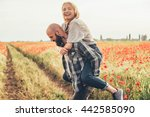 young happy couple having fun... | Shutterstock . vector #442585090