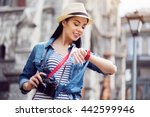 positive woman holding photo... | Shutterstock . vector #442599946