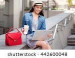 Cheerful Woman Using Laptop