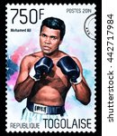 Small photo of NEW YORK, USA - CIRCA 2016: A postage stamp printed in Togo showing Muhammad Ali, circa 2014