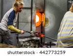 Two Blowing Glass Artists...