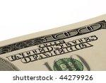 Macro shot of a corner of the US $100 bill - stock photo